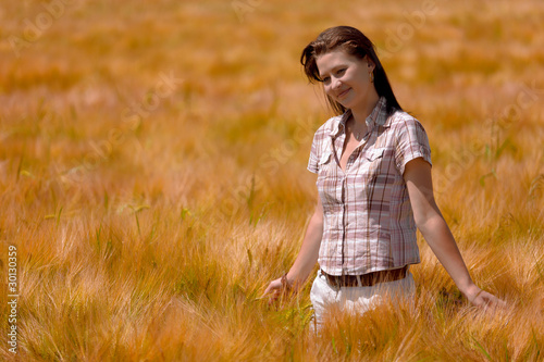 Beautiful woman in the field