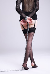 Legs in lingeries with chain on hands