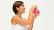 Brunette saving up money in a piggy bank