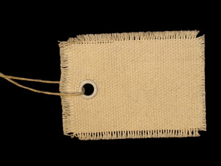 Blank textile tag isolated on black background