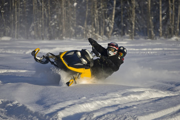 Teenage couple on snowmobile