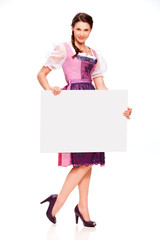 Pretty young girl with dirndl dress holding white board