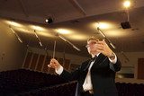 Male symphony conductor in action