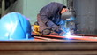 Welder at work in factory