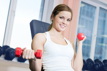 Beautiful sport woman doing exercise with dumbbell weight