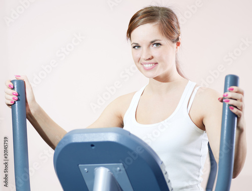 Young woman at the gym exercising.