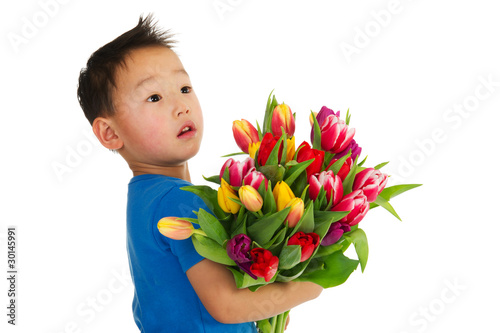 Asian boy with flowers
