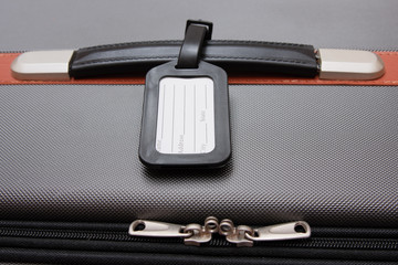 Black Luggage Tag On Baggage