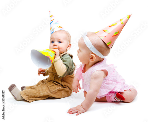 Two babies in party hats