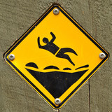 Danger: falling onto rocky surface sign in a walking track