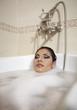 Beautiful latino woman taking bath