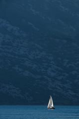 Yacht against cliffs