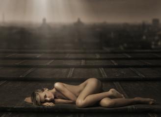 Beautiful naked woman laying