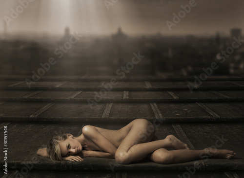 Beautiful naked woman laying