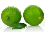 Limes with leaf on a white background