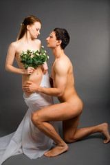 beauty woman and her admirer isolated on gray