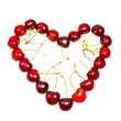 Heart from a sweet cherry on white background..