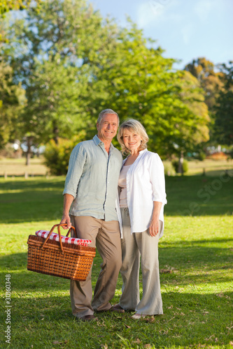 Retired couple looking for a place to  picnicking