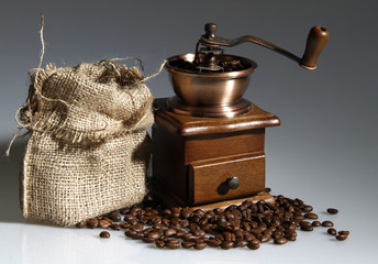 coffee mill with a sack of roasted beans