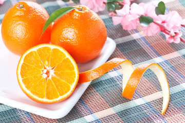 Tangerines on white shaped plate