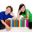 Kids and books isolated on white background