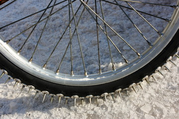 Close-up of a motorcycle studded tire tread for speedway racing
