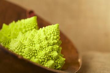 Romanesco Cauliflower broccoli in wooden bowl