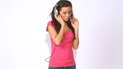 Lovely girl walks in and out, she listen music in headphones