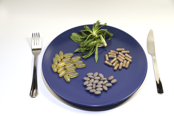 plate full of vitamins and supplements