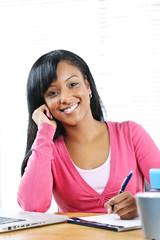 Happy female student studying