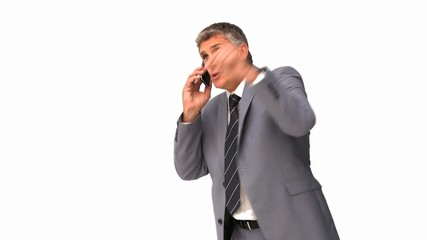Businessman getting nervous on phone