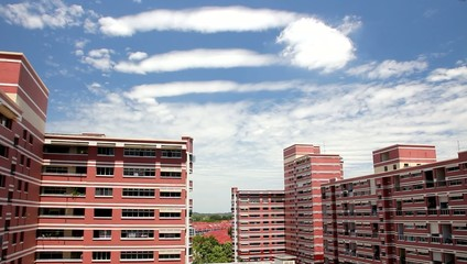 Clouds flloating by HDB and terrace house