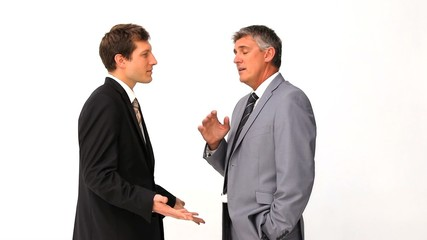 Businessman explaining something to his employee