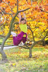 Little girl climbed on tree
