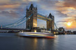 Tower Bridge with boat at evening, London, UK