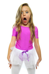 Little girl making funny face isolated on white
