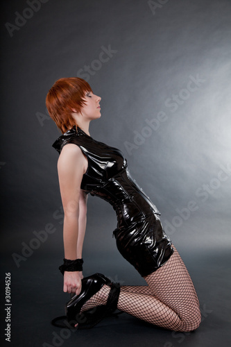 Bondaged woman in fetish outfit
