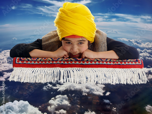 boy on a flying magic carpet