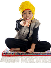 smiling boy on a flying magic carpet pointing