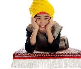 smiling boy on a flying magic carpet