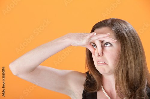 Woman Holds Her Nose