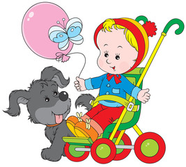 Toddler in a pram and funny pup