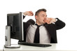 tired yawning businessman in black suit with computer
