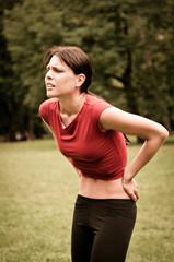 Backpain - sportswoman in pain