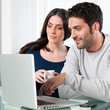 Couple with internet laptop