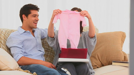 Man bringing clothes for his future baby