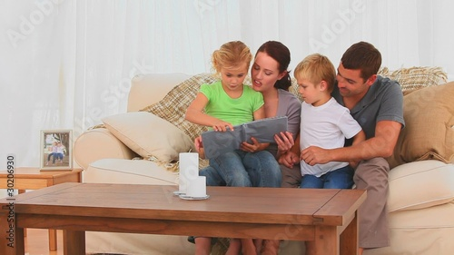 Pretty family looking at an album