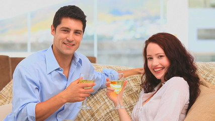 Lovely couple holding glasses of wine