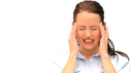 Brown-haired woman having an headache