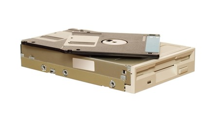 Floppy disk drive with diskettes isolated over white